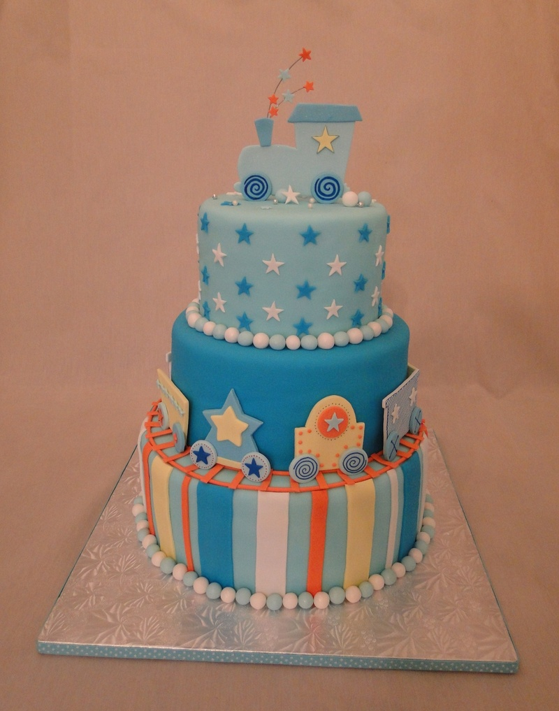 ... train cake was design to match the invitations for the baby shower